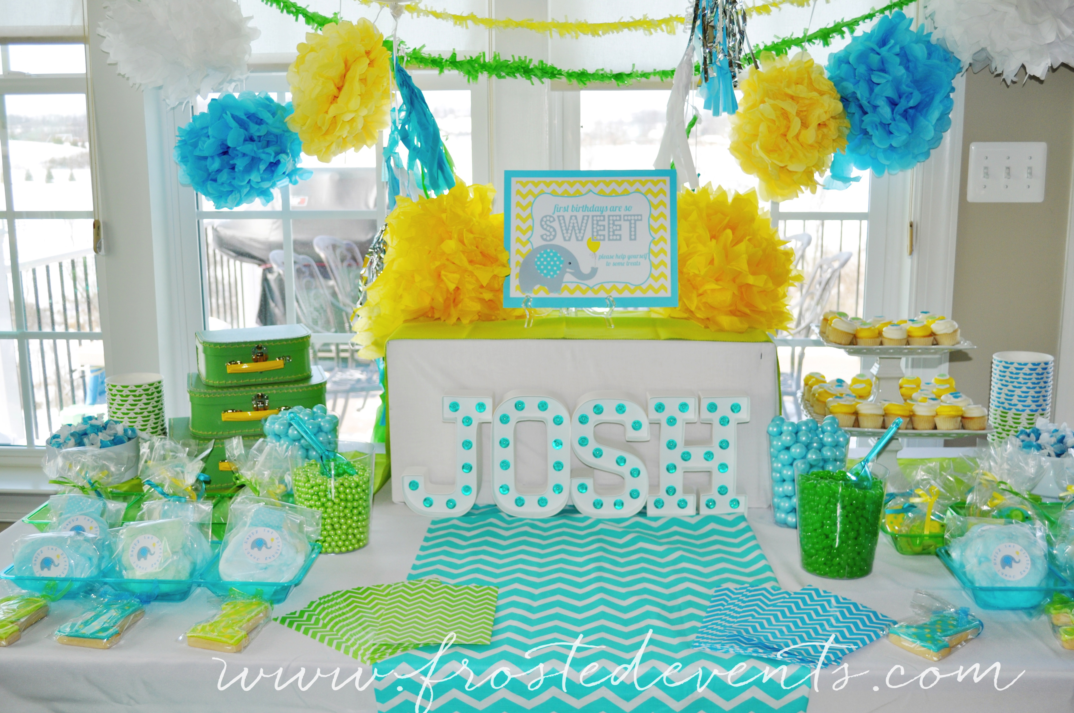 Dessert Table A Bright And Fun First Birthday Frosted Events Frostedevents The Cutest Little Boy Party In Aqua Blue Yellow Green