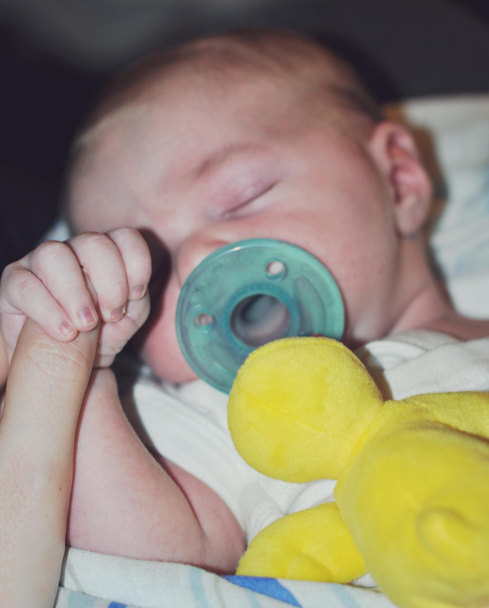 What is RSV ?Newborn holding finger -- Misty Nelson son Brady mommyblogger frostedmoms.com @frostedevents